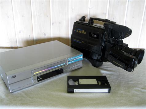 File:VHS recorder, camera and cassette